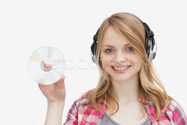 Mulher cd fones de ouvido branco Foto stock © wavebreak_media