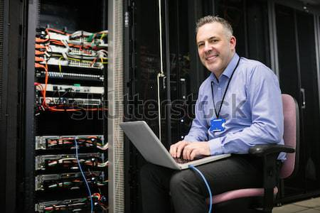 Technician using tablet pc to work on servers in data center Stock photo © wavebreak_media