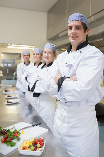 Team of Chef's standing with desserts in the kitchen Stock photo © wavebreak_media