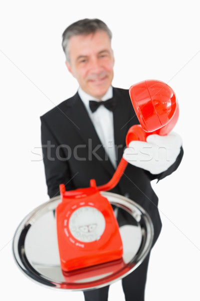 Waiter giving red phone on silver tray to someone Stock photo © wavebreak_media