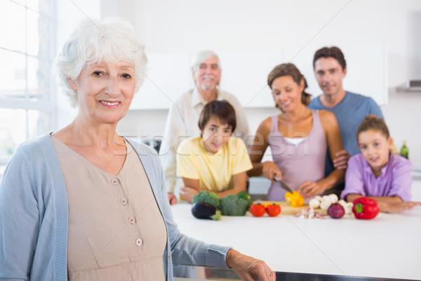Grandmother standing beside kitchen counter Stock photo © wavebreak_media