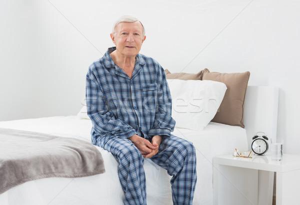 Yaşlı adam oturma yatak yatak odası ev Stok fotoğraf © wavebreak_media
