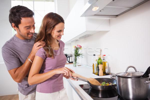 Woman making dinner with partner watching Stock photo © wavebreak_media