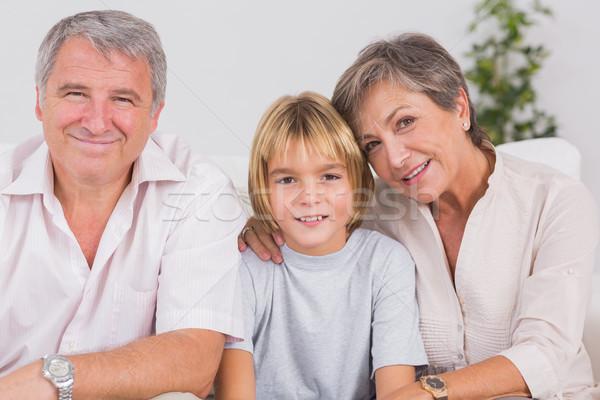 Portret mały chłopca dziadkowie uśmiechnięty posiedzenia Zdjęcia stock © wavebreak_media