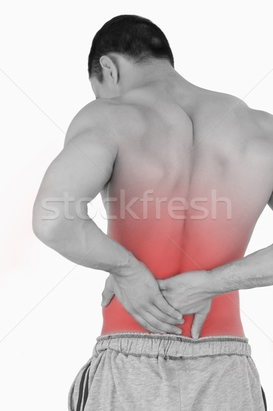 Young male suffering from back pain Stock photo © wavebreak_media