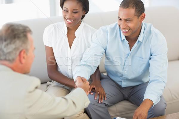 Fiatal pér kézfogás eladó kanapé iroda nő Stock fotó © wavebreak_media