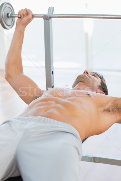 Shirtless fit man lifting the barbell bench press Stock photo © wavebreak_media