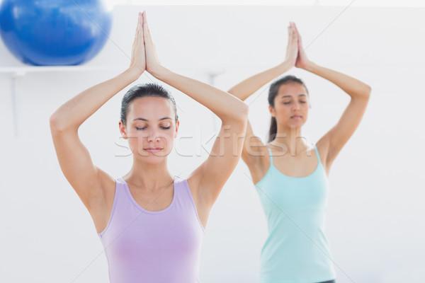 Sporty women with joined hands in fitness studio Stock photo © wavebreak_media