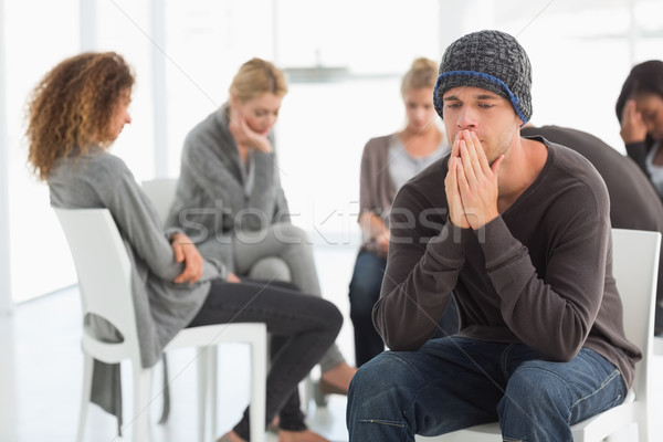 Upset man at rehab group with hands to face Stock photo © wavebreak_media