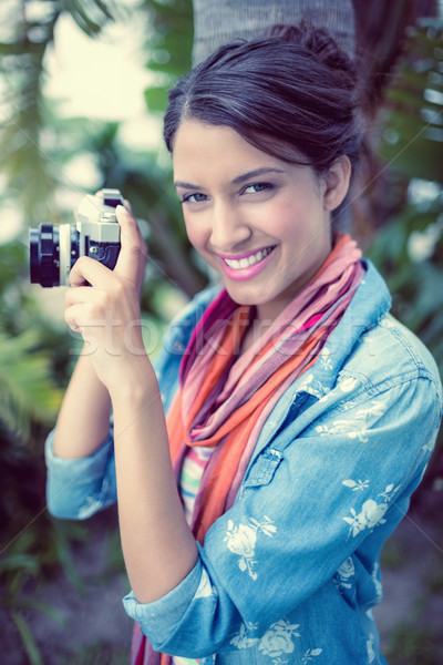 Cheerful brunette taking a photo outside smiling at camera Stock photo © wavebreak_media