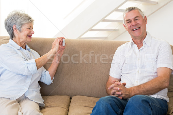 Retired woman taking photo of her partner on the couch Stock photo © wavebreak_media