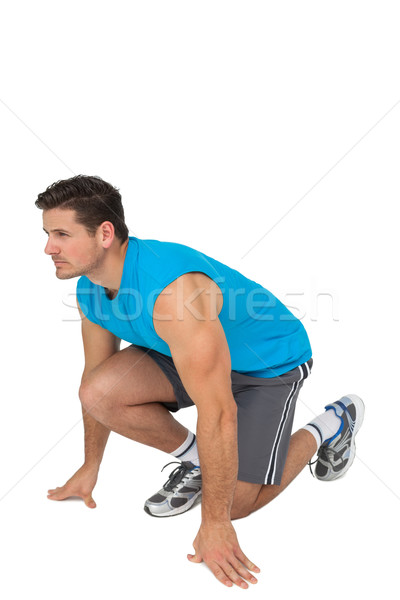 Side view of a young sporty man in running stance Stock photo © wavebreak_media