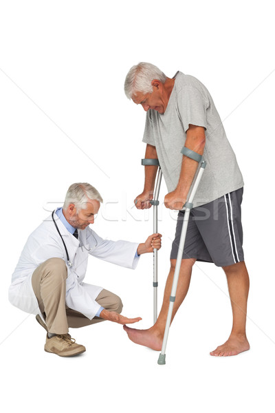 Side view of a doctor with senior man using walker Stock photo © wavebreak_media