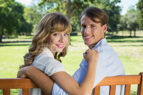 Couple relaxing on park bench together smiling at camera Stock photo © wavebreak_media
