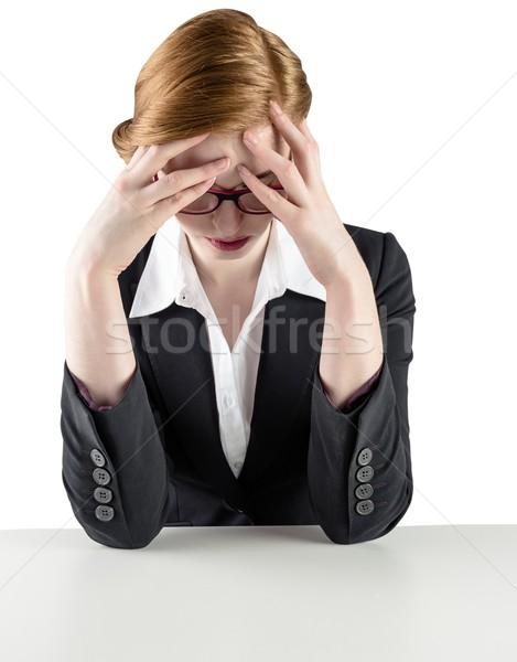 Redhead businesswoman with head in hands Stock photo © wavebreak_media