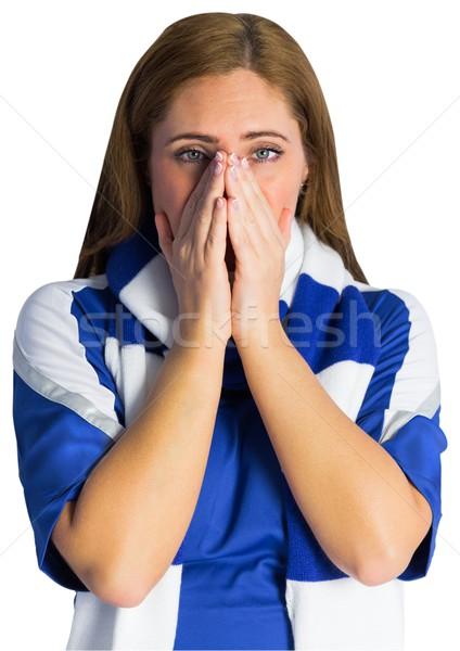 Pretty football fan looking nervous Stock photo © wavebreak_media