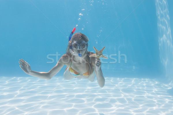 Cute blonde underwater in the swimming pool with snorkel and sta Stock photo © wavebreak_media