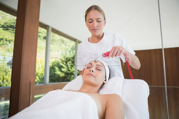 Stock photo: Peaceful brunette getting micro dermabrasion