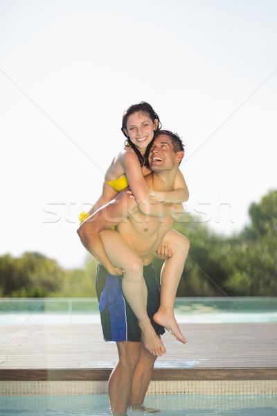Gorgeous couple having fun poolside on holidays Stock photo © wavebreak_media