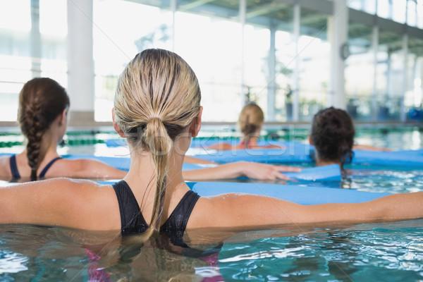 Kadın uygunluk sınıf su aerobik köpük Stok fotoğraf © wavebreak_media