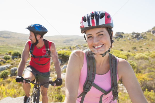 Fitt kerékpáros pár mosolyog kamera hegy Stock fotó © wavebreak_media