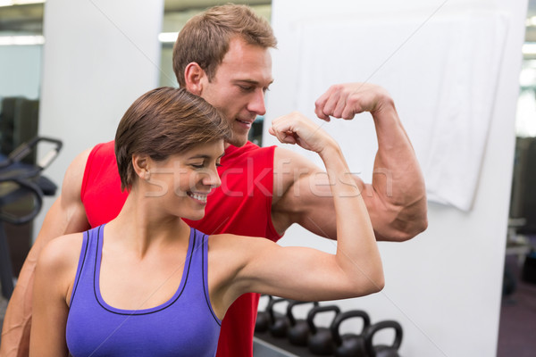 Fit attractive couple flexing their biceps Stock photo © wavebreak_media