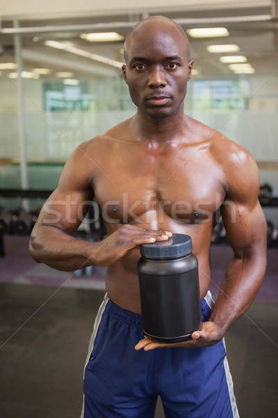 Muscular man with nutritional supplement Stock photo © wavebreak_media