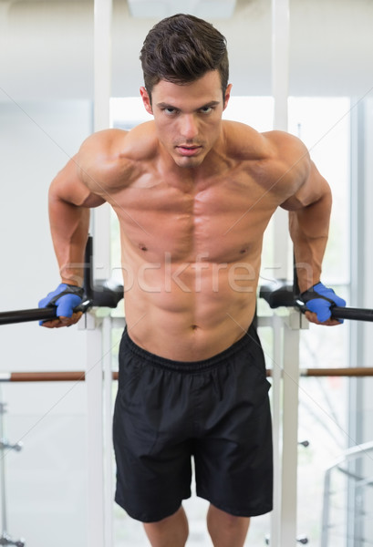 Muscular man doing crossfit fitness workout in gym Stock photo © wavebreak_media