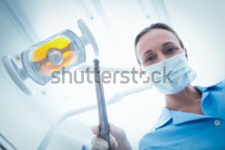Dentista máscara cirúrgica boné dental ferramentas Foto stock © wavebreak_media