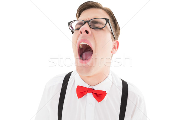 Nerdy hipster yawning in suspenders and bow tie Stock photo © wavebreak_media