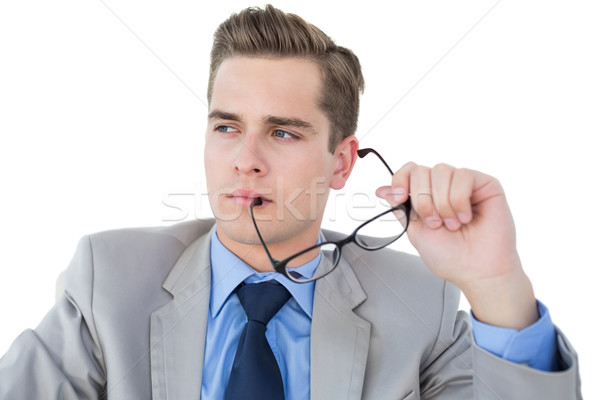 Stock photo: Nerdy businessman holding pen looking away