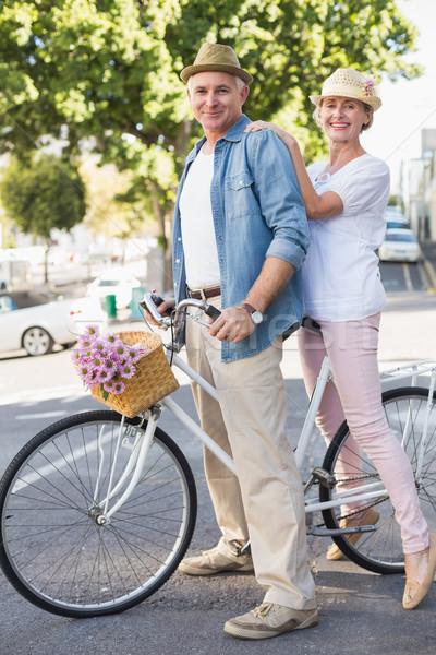 Boldog érett pár bicikli város napos idő Stock fotó © wavebreak_media
