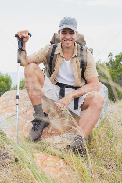 Hiking man sitting on mountain terrain Stock photo © wavebreak_media