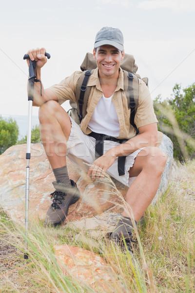 Yürüyüş adam oturma dağ arazi portre Stok fotoğraf © wavebreak_media