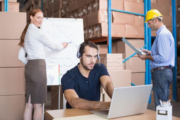 Warehouse team working together on shipment Stock photo © wavebreak_media