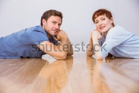 Couple lying on the floor Stock photo © wavebreak_media