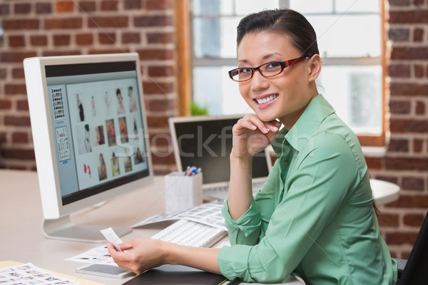 Smiling female photo editor using computer in office Stock photo © wavebreak_media