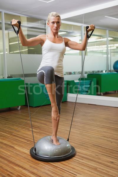 Woman doing fitness exercise in fitness studio Stock photo © wavebreak_media