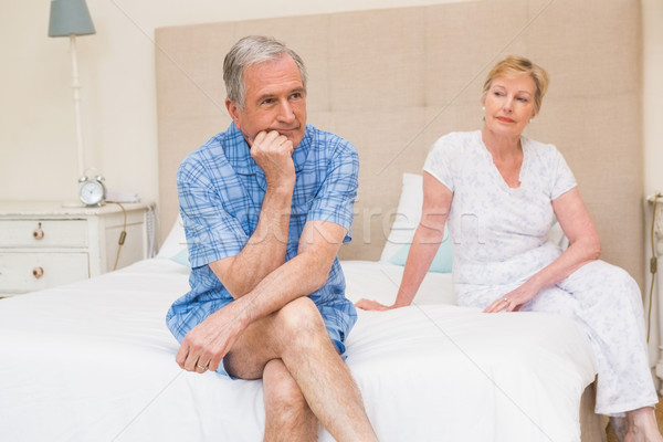 Senior couple not speaking after an argument on bed Stock photo © wavebreak_media