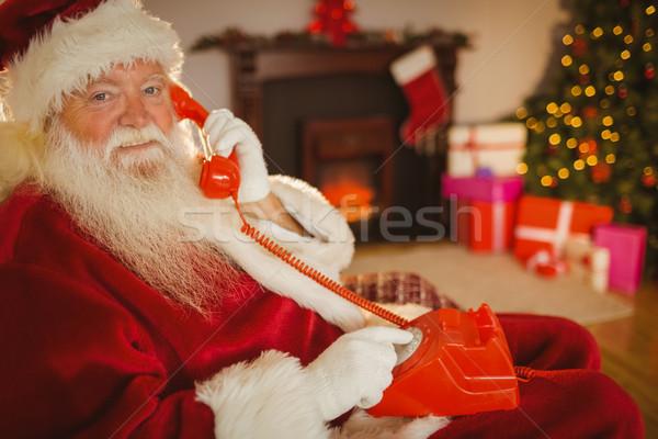 Smiling santa making a phone call Stock photo © wavebreak_media