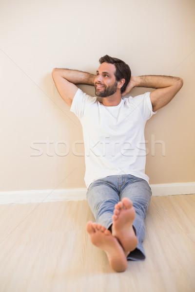 Happy man sitting on floor Stock photo © wavebreak_media