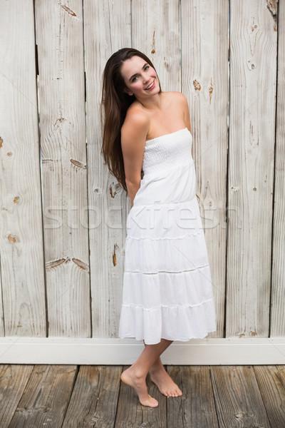 Bastante morena posando vestido branco Foto stock © wavebreak_media