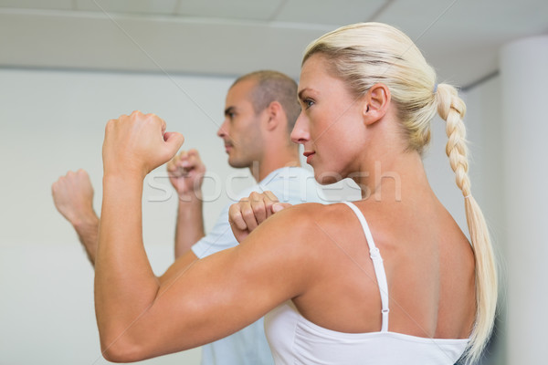 Sporty couple clenching fists at fitness studio Stock photo © wavebreak_media