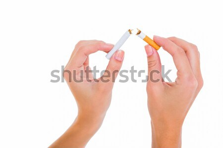 Womans hands snapping a cigarette Stock photo © wavebreak_media