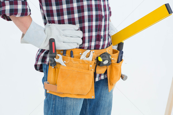 Repairman wearing tool belt while standing with hands on hips Stock photo © wavebreak_media