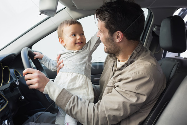 Father playing with baby in drivers seat Stock photo © wavebreak_media