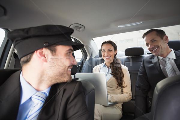 Bello autista sorridere clienti auto computer Foto d'archivio © wavebreak_media