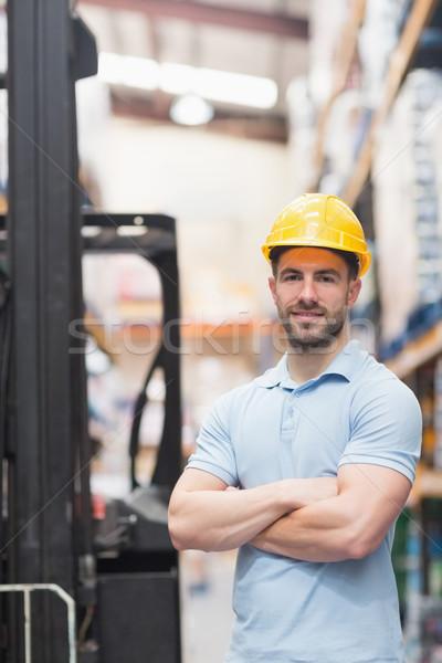 Worker wearing hard hat in warehouse Stock photo © wavebreak_media