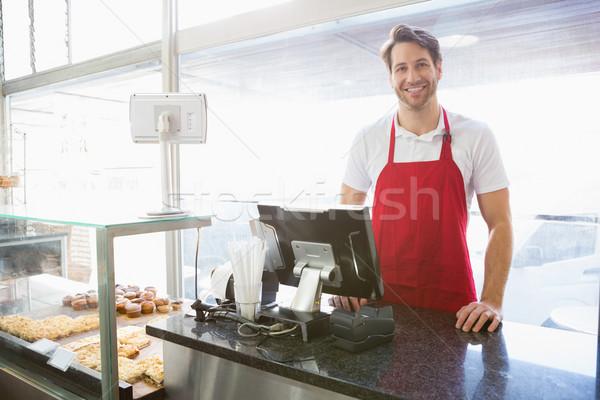 Lezser szerver pózol mögött pult pékség Stock fotó © wavebreak_media