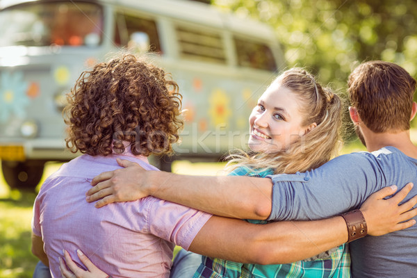 Hipster smiling at camera with friends  Stock photo © wavebreak_media